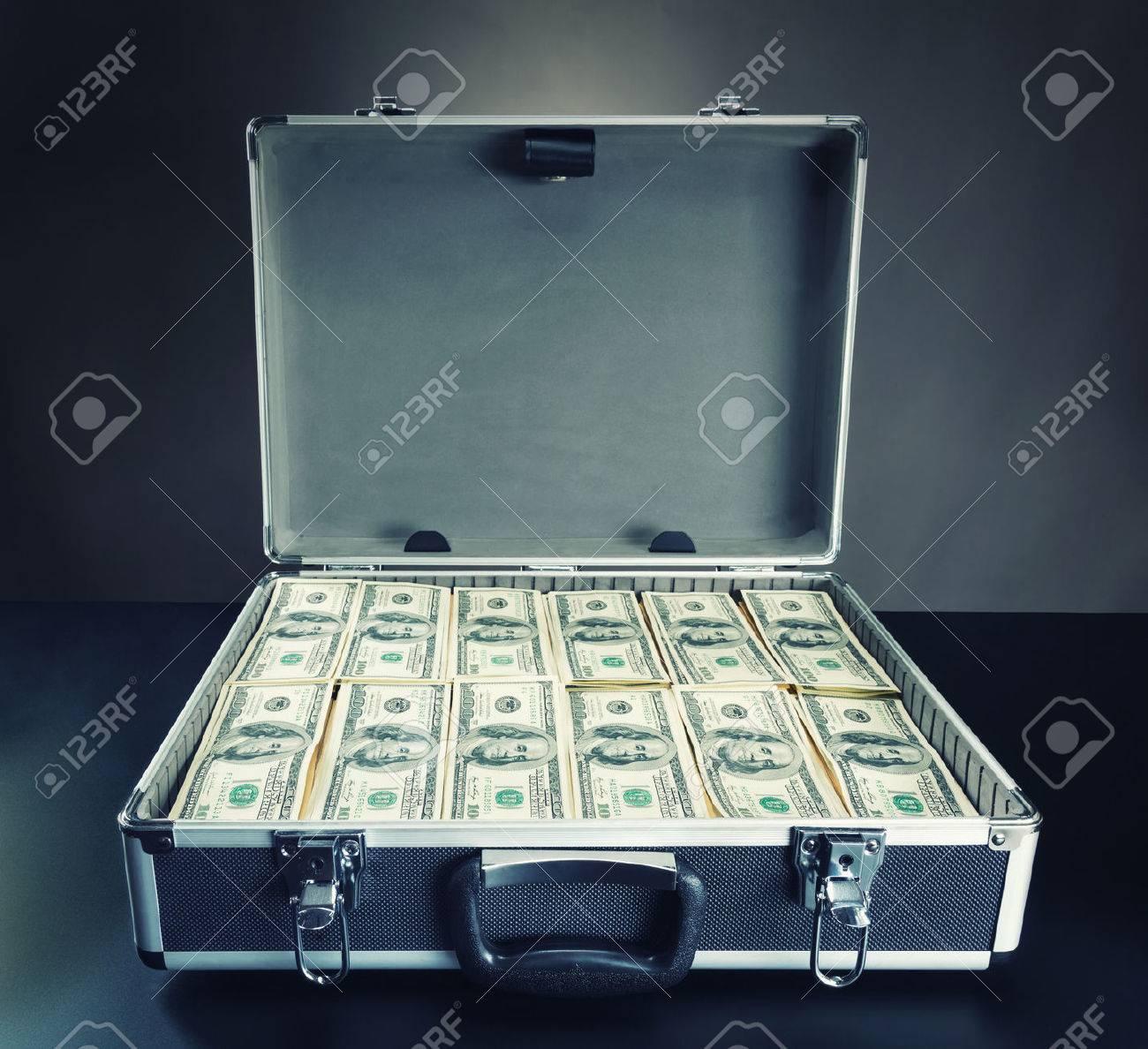 27832090-open-case-full-of-dollar-cash-on-gray.jpg